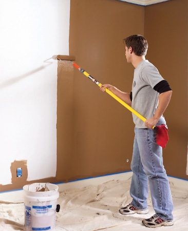 <b>Photo 2: Keep going! </b><br/>Don&#39;t let the roller get too dry. Keep it at least half loaded with paint.