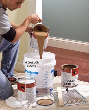 <b>Photo 1: Mix cans of paint</b></br> Mix paint from several cans to assure even color on your walls.