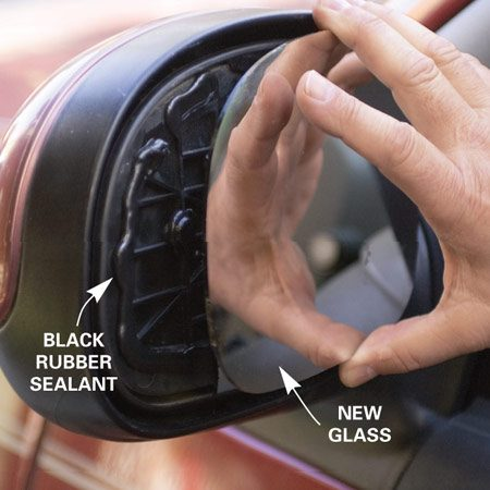 <b>Photo 2: Apply sealant</b></br> Apply a bead of black rubber sealant 3/4 in. in from the edge of the plastic base and a few dollops in other locations. Then press the new mirror into place.