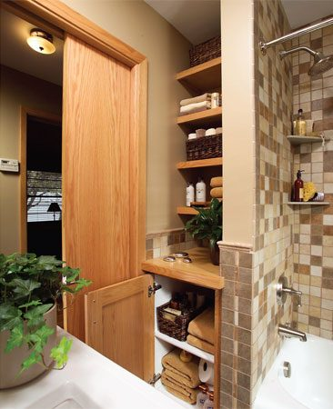 <b>More storage, fewer swinging doors</b></br> This corner is now functional storage with an open look and feel. Eliminating most of the cabinet doors and adding a pocket door created a greater sense of space.