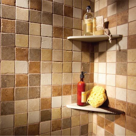 <b>Mixed tile colors</b></br> The rough edges and rich colors of the tile create the illusion of natural stone, but in reality, it's low-maintenance porcelain. Because the mosaic style breaks up the color pattern, the eye perceives that the room is larger.