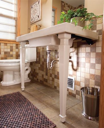 <b>Photo 1: Open sink console</b></br> To accent the open space underneath the console vanity, a polished chrome finish P-trap was used.