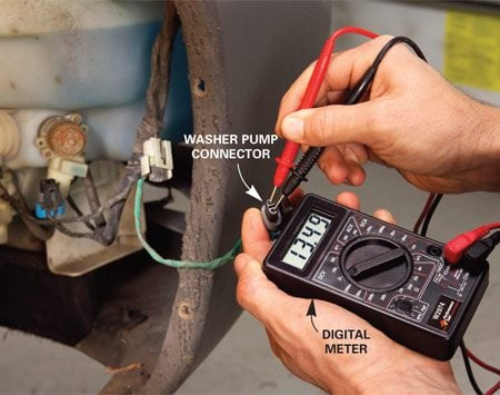 <b>Photo 3: Check power</b></br> If the fuse is good but the pump doesn't run, disconnect the connector at the pump and check for power with a volt meter. With the washer switch on, it should read 12 volts.