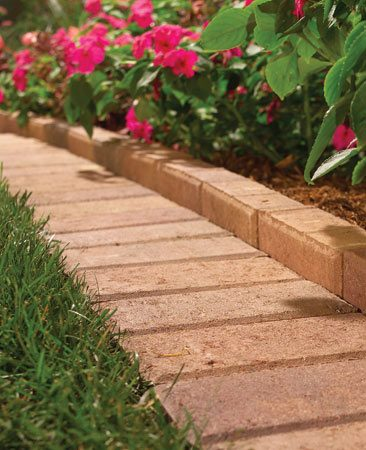 <b>Brick mowing border</b></br> A mowing border eliminates the grass-clipping chore.
