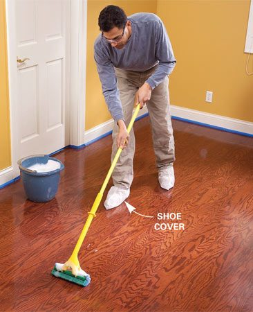 <b>Photo 6: Re-clean the floor</b></br> Damp-mop the floor with water and dishwashing liquid to neutralize the liquid etcher. Wear shoe covers to keep the floor clean.
