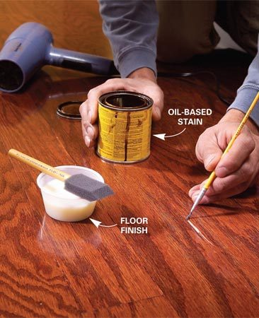 <b>Photo 8: Repair scratches</b></br> Touch up any scratches that have cut through the finish into the wood. Apply stain and dry it with a hair dryer. Then brush on a light coat of finish and dry it.