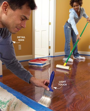 "<b>Photo 11: Fix drips quickly</b></br> Smooth out drips or puddles with a polyester brush. Stick close to the ""pad person"" to fix drips before they begin to dry."