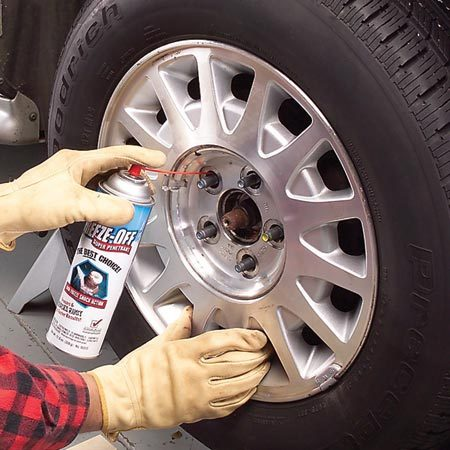 <b>Photo 1: Apply penetrating fluid</b></br> Spray a generous amount of rust penetrant into each mounting hole. Let it sit for five minutes. Rotate the tire a half turn and reapply the spray.
