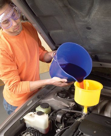 <b>Photo 3: Add coolant</b></br> Stir 1 gallon of full-strength (not premixed) coolant and 1 gallon of distilled water together in a clean bucket before adding the mix to the radiator.