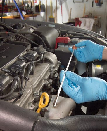 "<b>Photo 3: Check and top off all fluids</b></br> With the engine off, check power steering fluid, brake fluid, coolant, windshield washer and engine oil. Most automatic transmissions must be checked with the engine hot and running and the gearshift in ""park."" Check your owner's manual to confirm. Look for the power steering fluid level to reach the COLD mark on the dipstick. If it's low, check your owner's manual and buy the right fluid for your vehicle."
