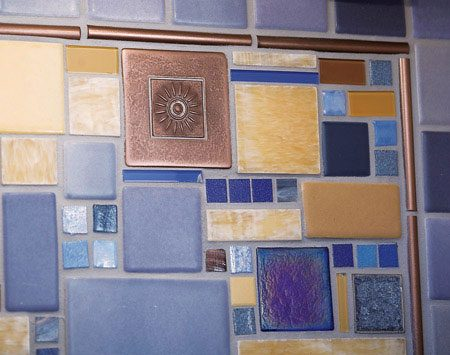 <b>Finished look</b></br> The tile was installed following the rough layout, then grouted with a neutral, light gray grout.