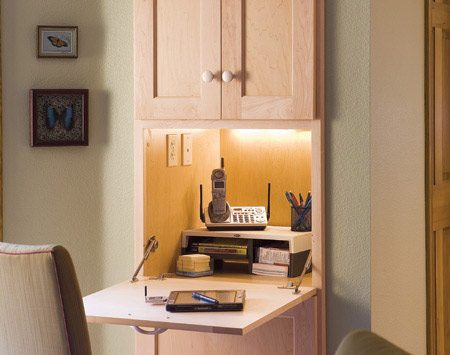 "<b>Nerve center</b></br> The ""nerve center"" is a feature Maughan includes in nearly every kitchen she designs. The space serves as office, computer center, mail-sorting area and cell phone charging station. The desk surface swings up to become a door for hiding the mess when needed. Since the unit is recessed into the pantry wall, it doesn't intrude on space needed for cabinets or appliances."