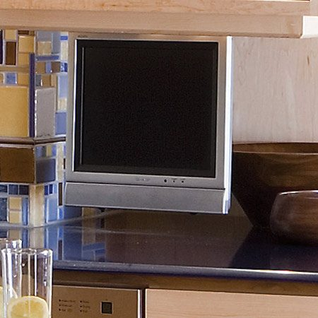 "<b>Hidden TV</b></br> A swing-down flat panel TV is easily ""taken out"" and ""put away"" as needed, and stays up and out of the way of spills."