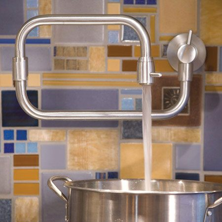 <b>Custom pot filler</b><br/>The pot filler faucet above the stove saves mess and steps and allows the filling of large pots that wouldn't otherwise fit under a conventional sink faucet.
