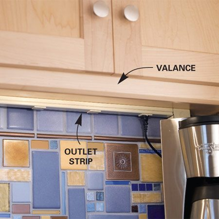 <b>Hidden outlets</b><br/>Electrical outlet strips mounted on the underside of the upper cabinets provide plenty of plug-ins for small appliances. A valance along the front edge of the cabinet helps conceal them.