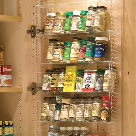 <b>Spice rack</b></br> Easy-to-use storage was created by narrowing the shelves inside the cabinet by a few inches, then mounting an adjustable spice rack on the back of the cabinet door closest to the cooktop, right where a chef would want it.