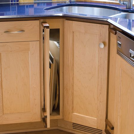 <b>Vertical storage</b><br/>Storage for trays and cookie sheets was tucked into the sliver of space created by the corner sink and cabinet.