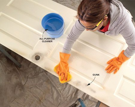 <b>Don't paint dirt</b></br> Scrub oil and dirt off the door so the primer can bond fully to the old paint.