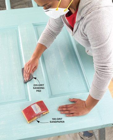 <b>Smooth between coats</b></br> Lightly sand the entire door between coats with 180- to 220-grit paper. Use a sanding sponge for shaped areas.