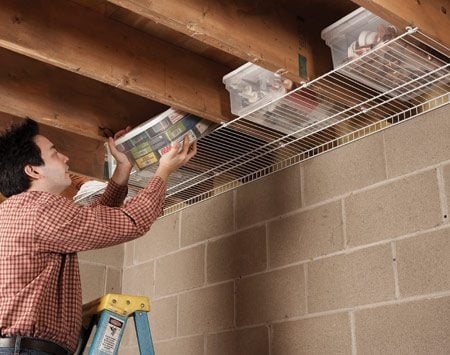 <b>Wire shelf</b><br/>Joist cavities are the perfect size for plastic storage containers.