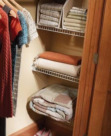 <b>Closet cubbies</b><br/>Make the most of the recesses at the ends of your closet with wire shelving.