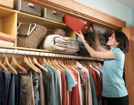 <b>Two-story shelf</b></br> Double the shelf space in your closet by adding a second shelf above the existing one.