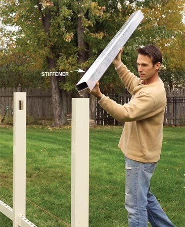 <b>Photo 7: Add stiffeners</b><br/>Drop metal stiffeners into posts at gates, ends and other locations where required for extra strength.