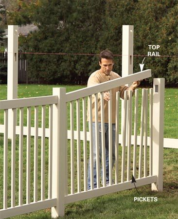 <b>Photo 8: Add pickets</b><br/>Slip pickets into the bottom rail. Snap the top rail into one post, slip it over the picket tops and snap it into the other post.