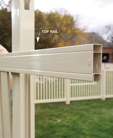 <b>Photo 11: Add top rails</b><br/>Slide the top rail over the boards, locking the end into the rail hole, and then back into the rail hole at the opposite end.