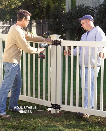 <b>Photo 13: Hang the gate</b></br> Screw the hinges and latch to the gate. Then center the gate in the opening and screw a catch to the other post.