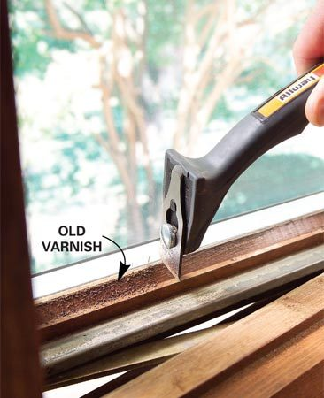 <b>Photo 2: Scrape off loose finish</b></br> Use a sharp scraper to remove old finish. Pull the scraper smoothly and carefully to avoid gouging the wood.