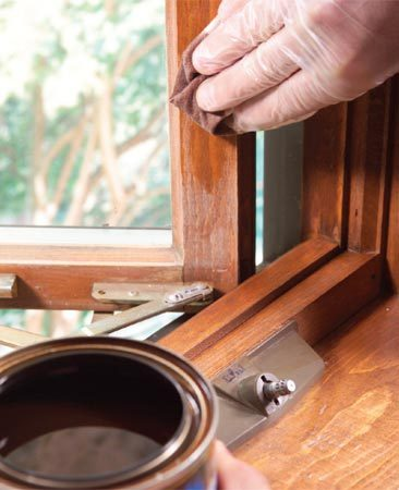 <b>Photo 4: Apply stain and finish</b></br> Rub stain into the sanded sections of the window. Wipe off quickly, then apply more as needed to darken the color.