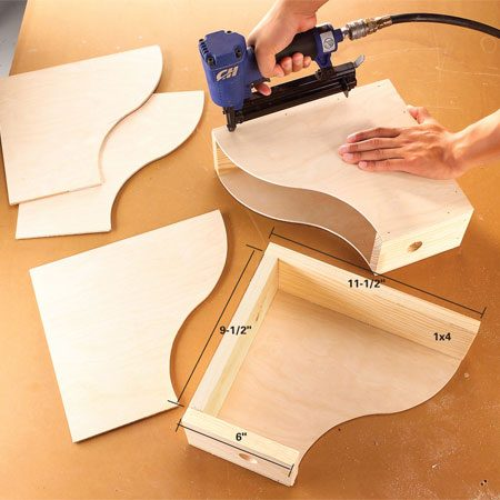 <b>Photo 3: Nail the pieces</b></br> Saw pine boards into 6-, 9-1/2- and 11-1/2-in. lengths. Drill 1-in.-diameter finger pulls in the 6-in. pieces, then nail the frames together. Nail the sides to the frames with 1-in. finish nails, sand as needed and apply a finish.