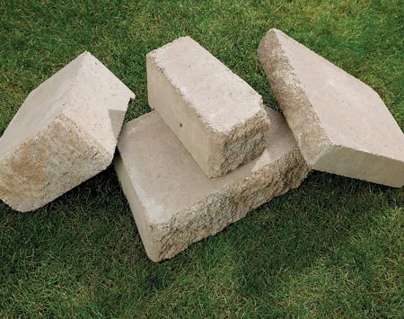 """<b>Modular concrete blocks</b></br> Wall block systems are designed for easy assembly. This system has both 6-in.- and 3-in.-thick blocks in a variety of widths. A flange on the back evenly spaces and interlocks the wall. We used a """"split-face, weathered"""" style, which is available in several colors. For other styles, check online or visit a home center or landscape supplier."""