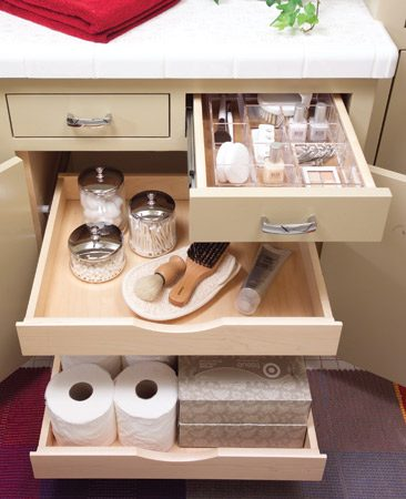 <b>New rollouts, old cabinet</b></br> The vanity cabinet is original, but for about $1,500, the new door and drawers were constructed with wipe-clean Melamine bottoms and maple sides decked out with metal slides.