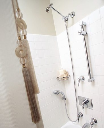 <b>Shower curtain pull</b></br> A last little splurge of elegance lies in the Kravet silk tassel shower curtain pull ($75). Costing half as much as the Restoration Hardware shower curtain itself, the tassel adds a touch of luxury to this otherwise thrifty remodel.