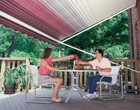 <b>Retractable awning with support arm</b></br> Large retractable awnings need a diagonal support arm.