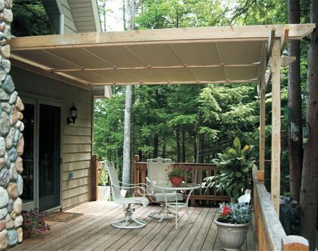 <b>Retractable canopy on wooden posts</b></br> Canopy systems can be installed on wooden framing to blend in with an existing deck.
