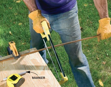 <b>Photo 1: Cut the rebar into stakes</b></br> Cut 1/2-in. rebar into ten 10-in. stakes. Saw about two-thirds of the way through with a hacksaw, then snap off the stake.