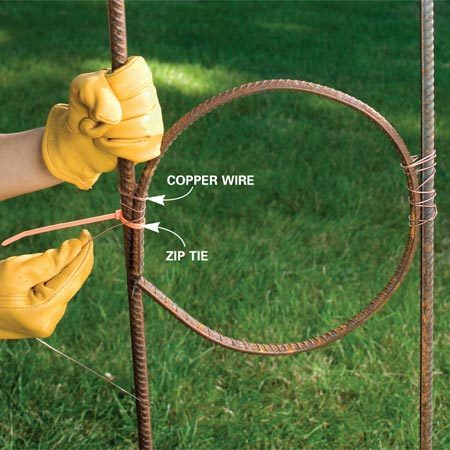 <b>Photo 8: Tie the circles to the arches</b></br> Position the circles between the arches with cable ties. Then tightly bind the circles to the arches with 2-ft. lengths of copper wire. Wire down as much of the side of the circle as you can to make the circle stable.