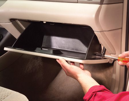 <b>Photo 1: Where is it?</b></br> Unscrew the glove box hinges. Then press in on both sides of the glove box to tilt it down and pull it free to access the filter tray.