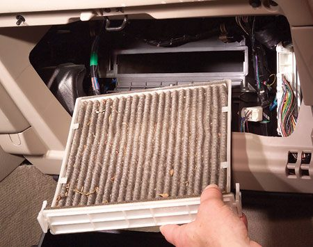 <b>Photo 2: Out with the old </b></br> Slide out the filter tray and the old filter. Note the orientation of the pleats and install the new filter in the same direction.