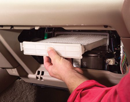 <b>Photo 3: In with the new</b></br> Slide the filter tray back into place and reassemble the glove box.