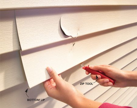 <b>Photo 1: A zip tool is the key</b></br> Slide the zip tool along the bottom edge to release the vinyl siding from the piece below it.