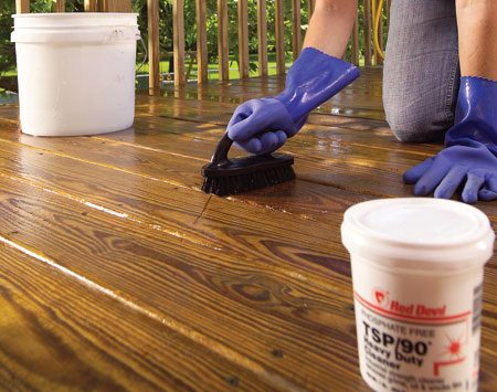 <b>Photo 6: Scrub stubborn stains</b><br/>Remove mold, mildew or algae using non-chlorine bleach. Scrub the area with a nylon brush, then rinse with water. For tougher stains, repeat the process with a TSP substitute.