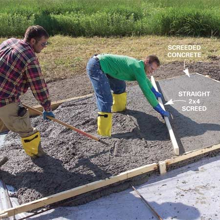 <b>Photo 7: Pour and level the concrete</b></br> Drag a straight 2x4 (screed board) across the top of the forms to level the concrete. Make multiple passes if needed to create a flat, evenly filled area. Have a helper add or remove concrete in front of the screed as you pull it.