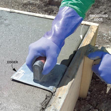 <b>Photo 9: Round off slab edges</b></br> Round the edges of the slab with an edging tool after any surface water disappears. Work the edger until the edge is solid and smooth