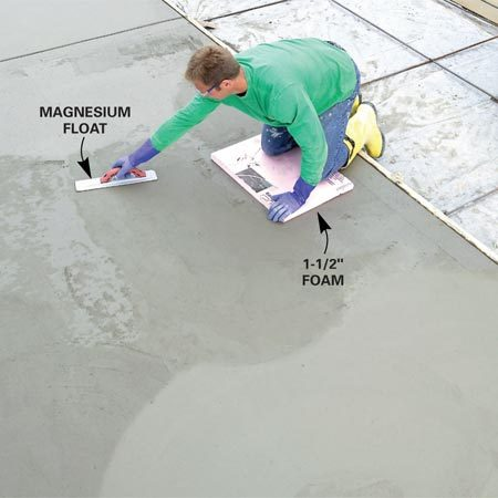 <b>Photo 12: Smooth with trowels</b></br> Sweep a magnesium float over the concrete to smooth and flatten the surface when the concrete has hardened enough to support your weight. Then further smooth the surface with a steel trowel.