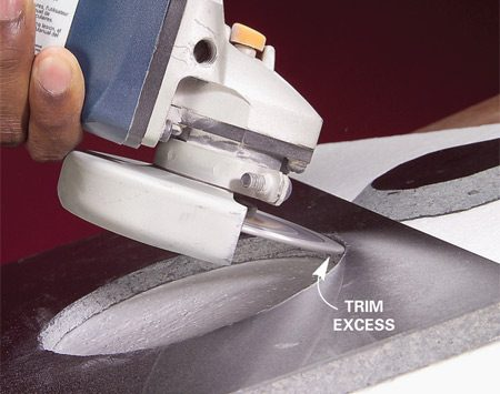 <b>Photo 3: Smooth the cut edge</b></br> Grind off rough edges and trim back to the line for a perfect curve.