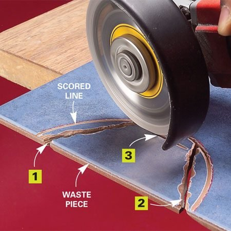 <b>Photo 1: Score and rough cut</b></br> Score the profile with the saw, then cut in from the edge of the tile to remove as much waste as possible.